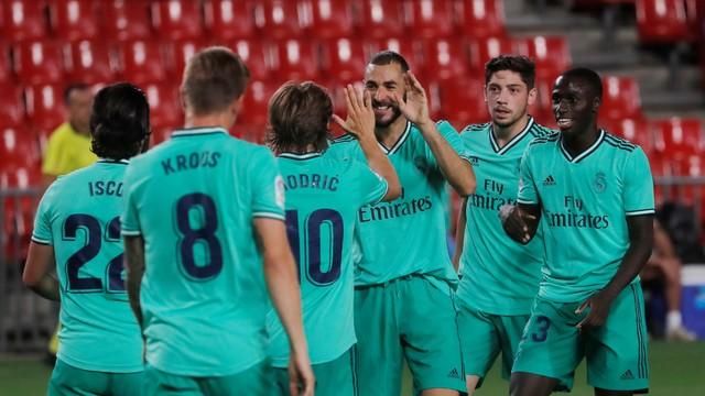 Real Madrid suporta pressão, bate Granada e fica a uma vitória do título do Campeonato Espanhol.